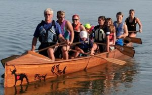Image of people dragon boat racing